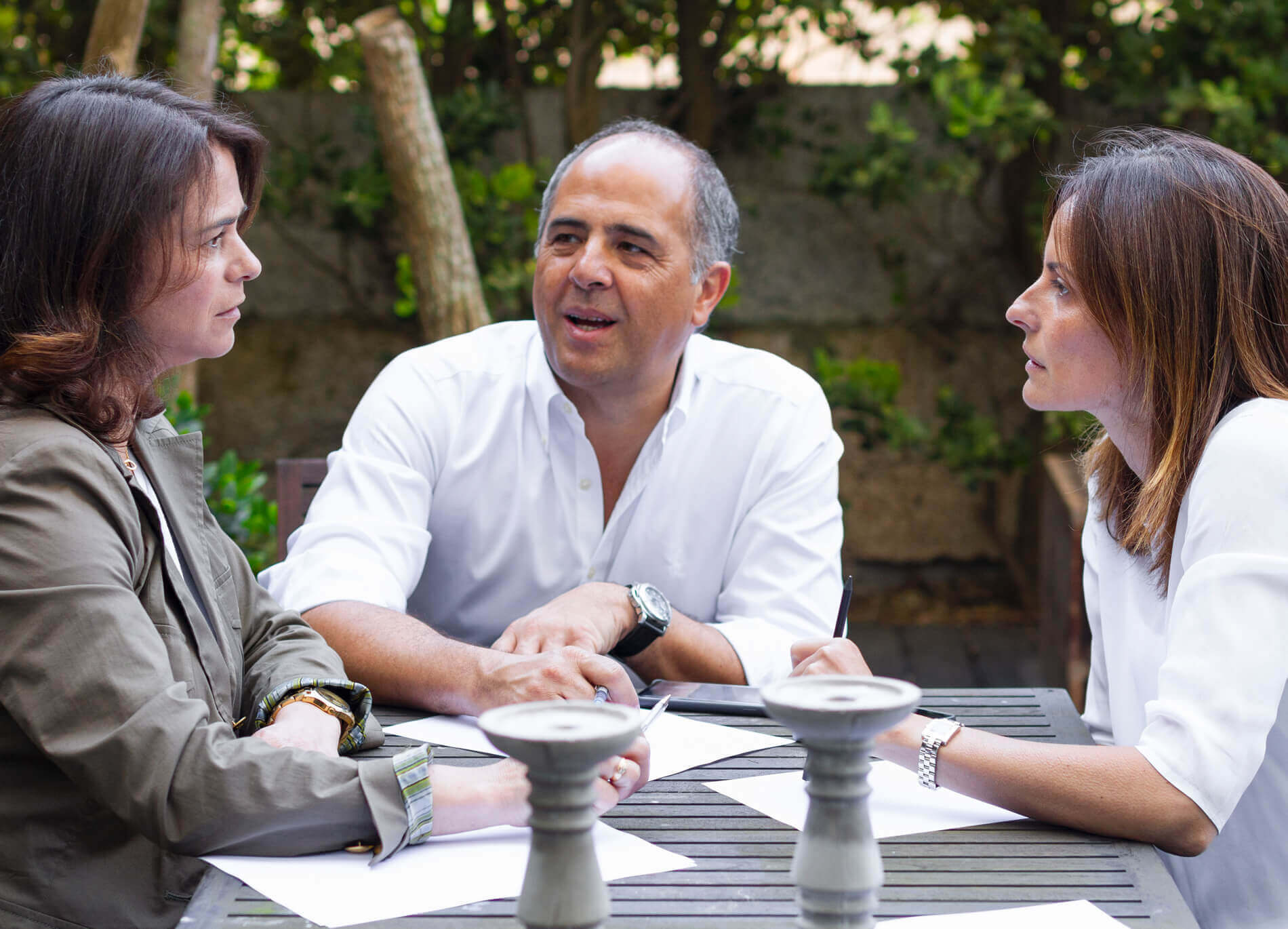 Marialma's team having a business meeting in the backyard.