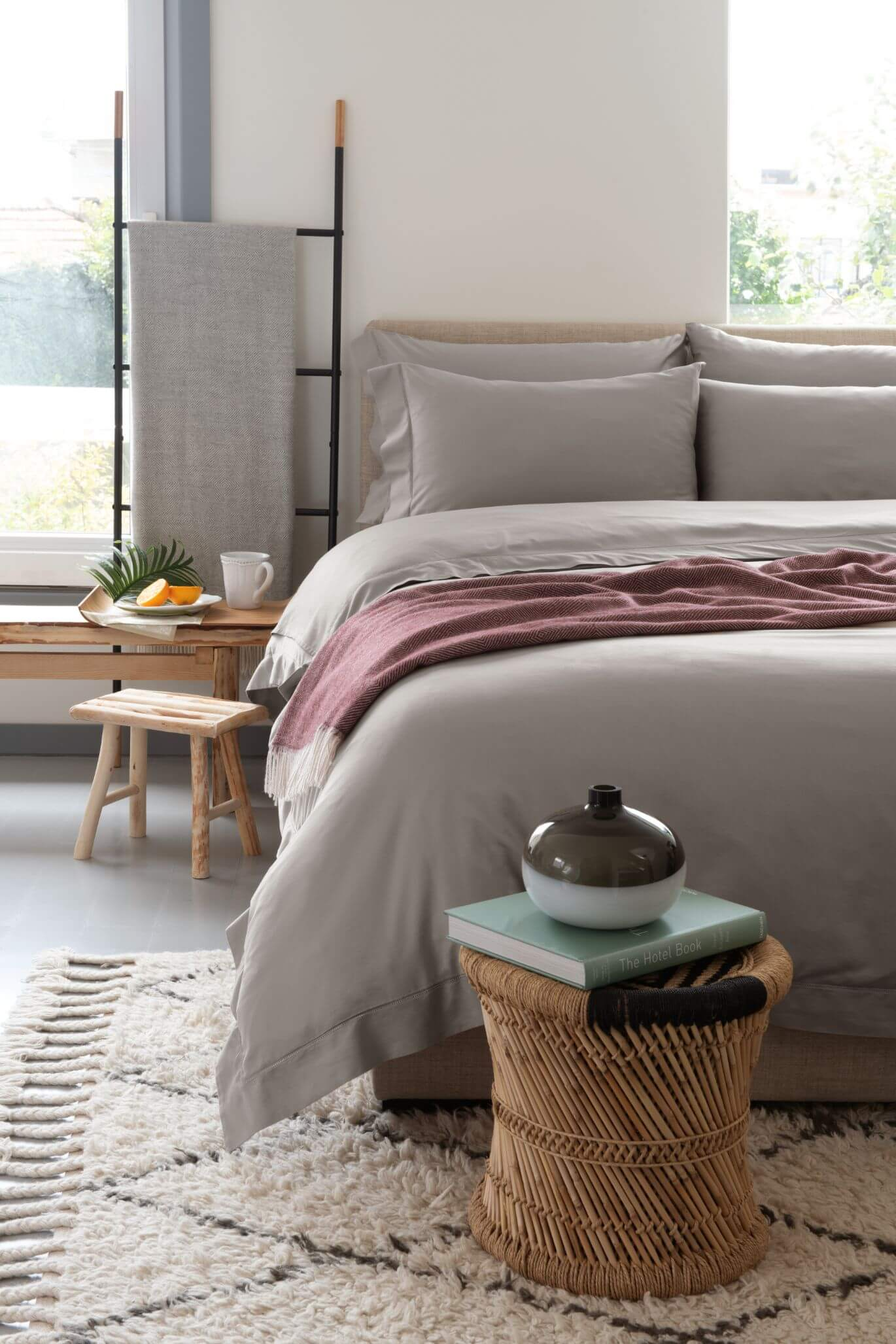 A bedroom with Marialma's bed sheets
