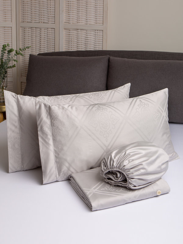 Marialma's Grey Sensitive Zinc Duvet Cover Set with Jacquard Faro folded on top of a bed