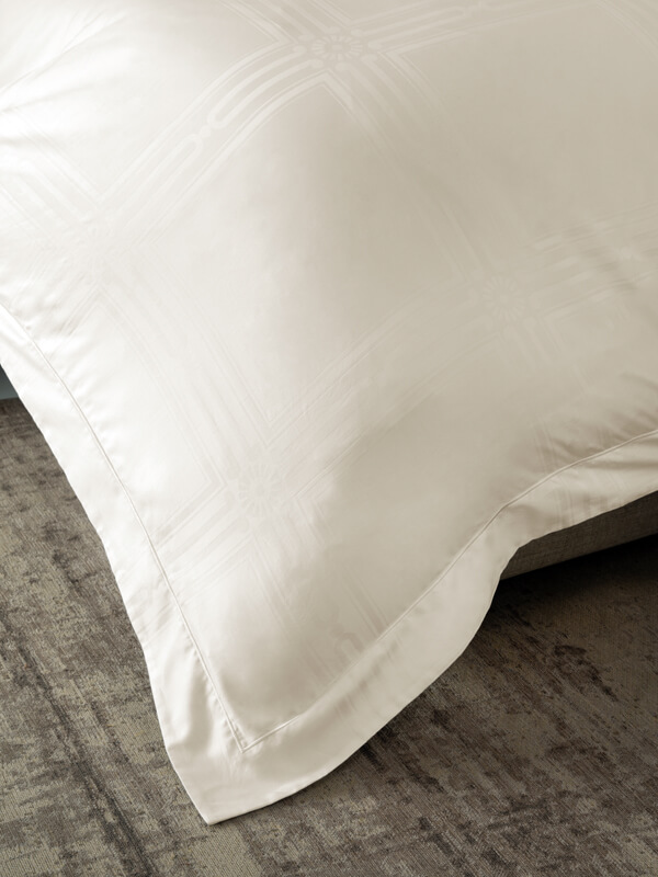 Detail of Marialma's Ivory Cosmetic Algae Duvet Cover with Jacquard pattern