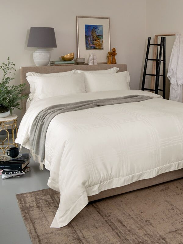 Bedroom featuring bed with Marialma's Ivory Cosmetic Algae Pillowcase Set with jacquard pattern