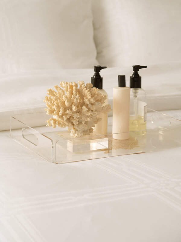 Skincare set on top of Marialma's Ivory Cosmetic Algae Duvet Cover with Jacquard Pattern