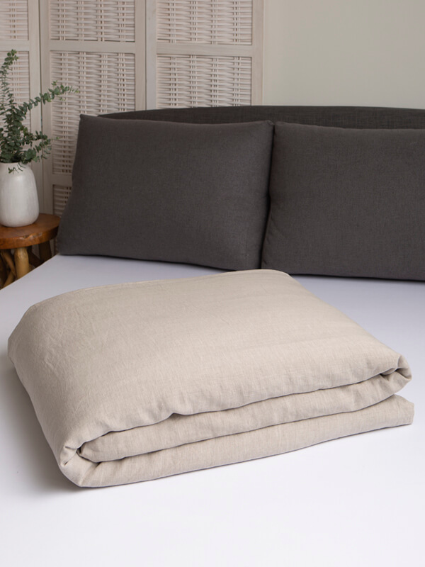 Marialma's Natural Hemp Duvet Cover folded on top of a bed