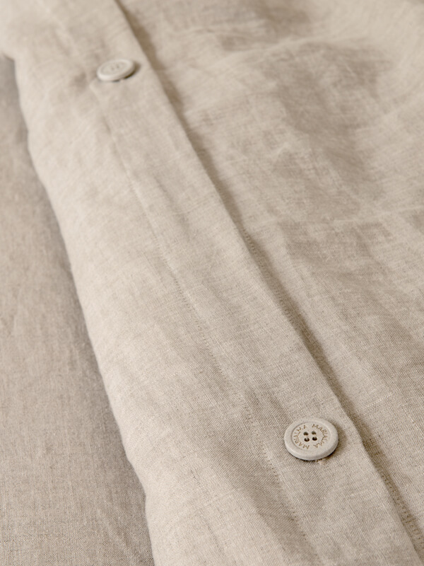 Detail of 100% Biodegradable buttons of Marialma's Natural Hemp Duvet Cover