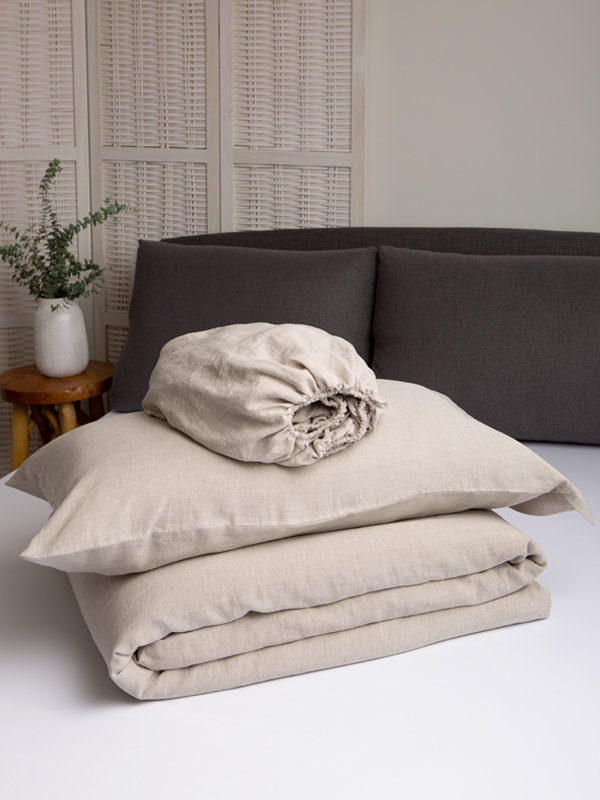 Marialma's Natural Hemp Duvet Set folded on top of a bed