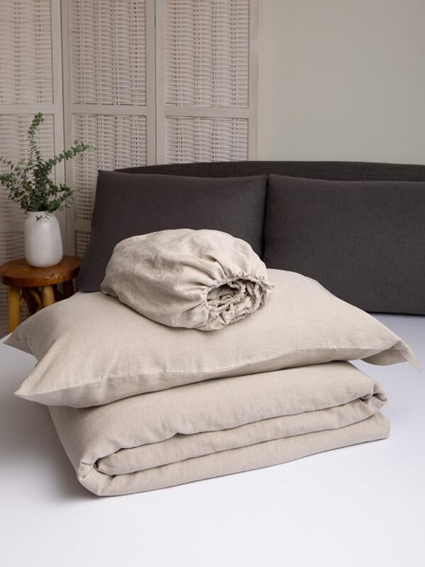 Marialma's Natural Hemp Duvet Set folded on top of a bed
