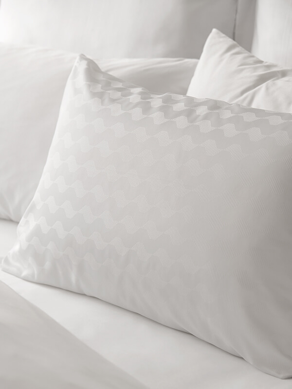 Marialma's White Cosmetic Algae Pillowcase Set with a jacquard pattern inspired by Portuguese sidewalk