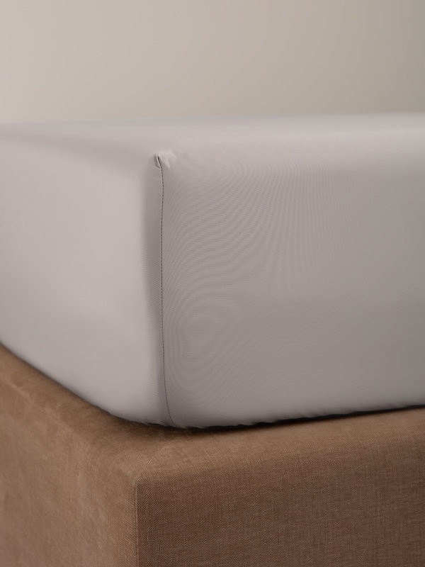Detail of the corner of a bed with Marialma's Grey Fitted Sheet