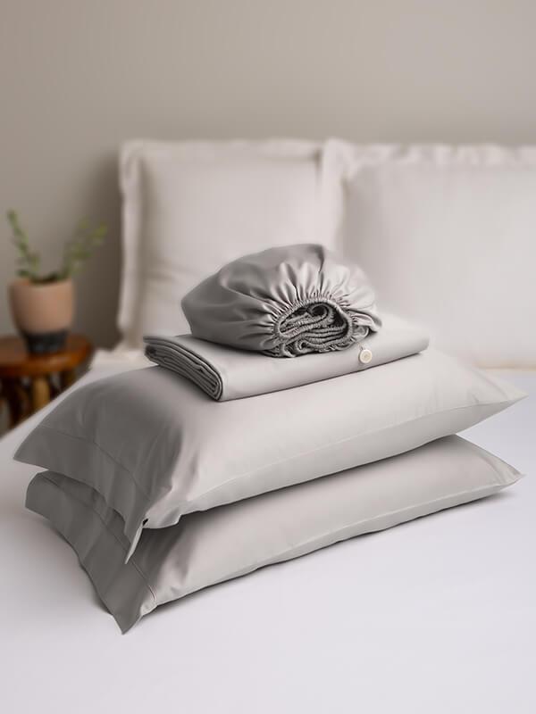 Marialma's Grey Sensitive Zinc Duvet Cover Set on top of a bed