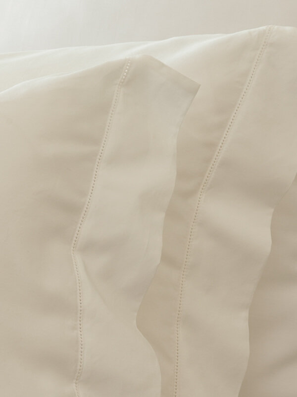 Detail of Marialma's Ivory Cosmetic Algae Pillowcase Set