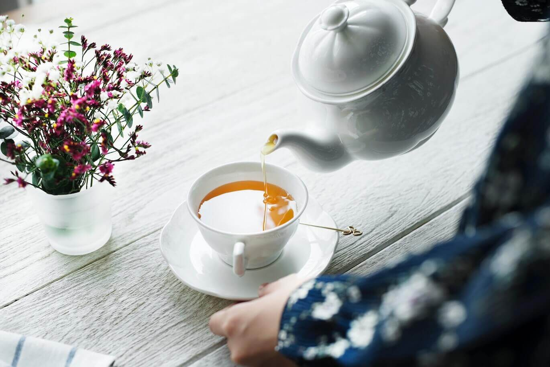 woman serving tea