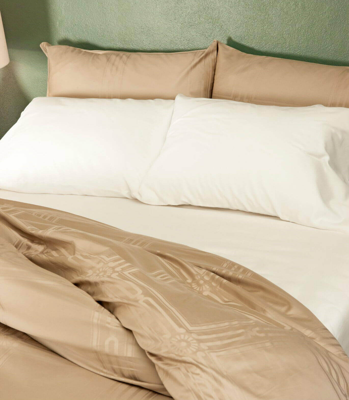 marialma's beige and white bed sheets in a green bedroom