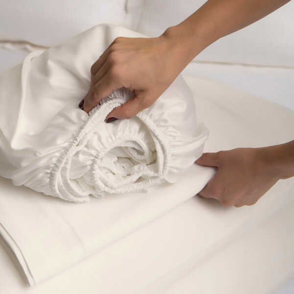 Marialma's Cosmetic Algae Sheet set on top of a bed