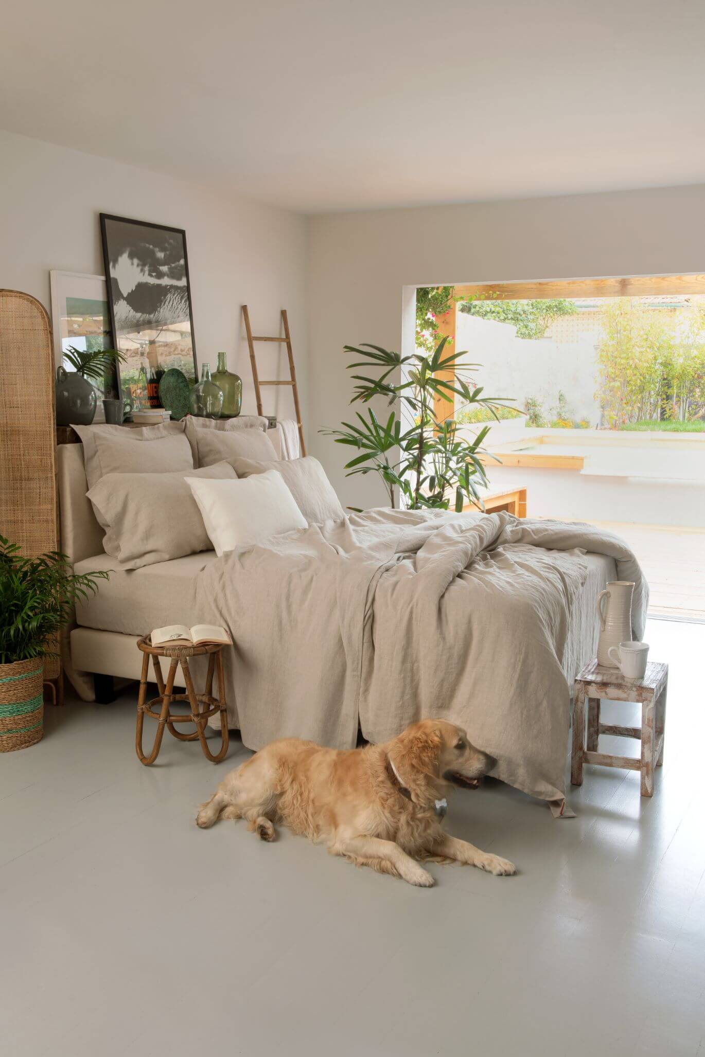 Marialma's Natural Hemp 100% bed sheets in a sustainable bedroom with golden retriever