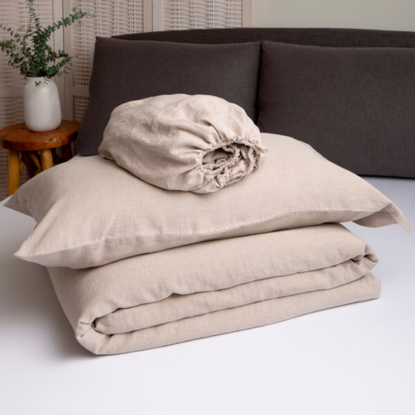 Marialma's natural hemp duvet cover set folded on top of a bed