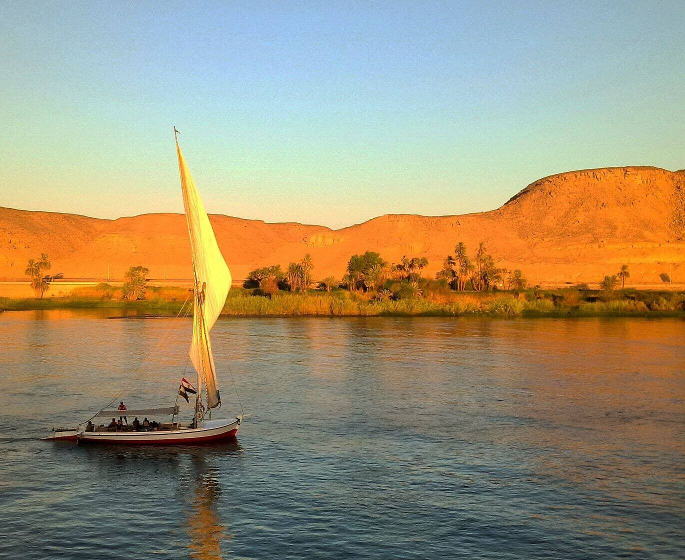 sailing boat in the middle of Nile river