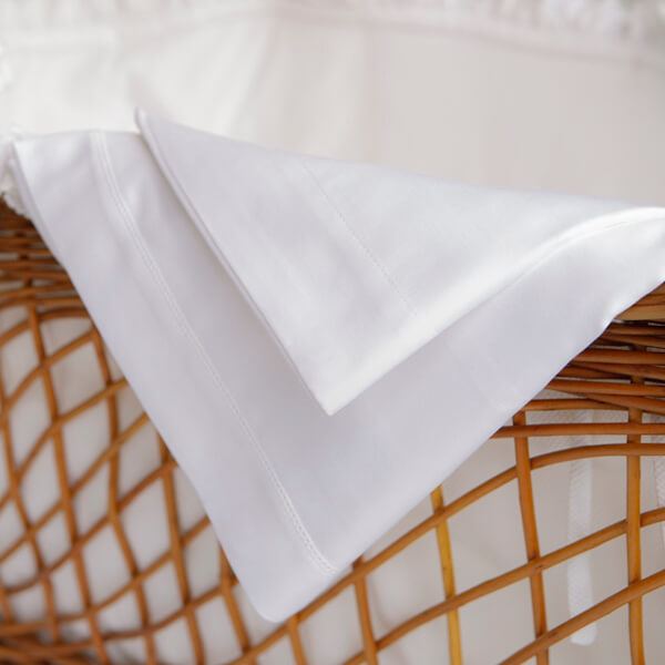 Marialma's white bed sheets in a wicker basket