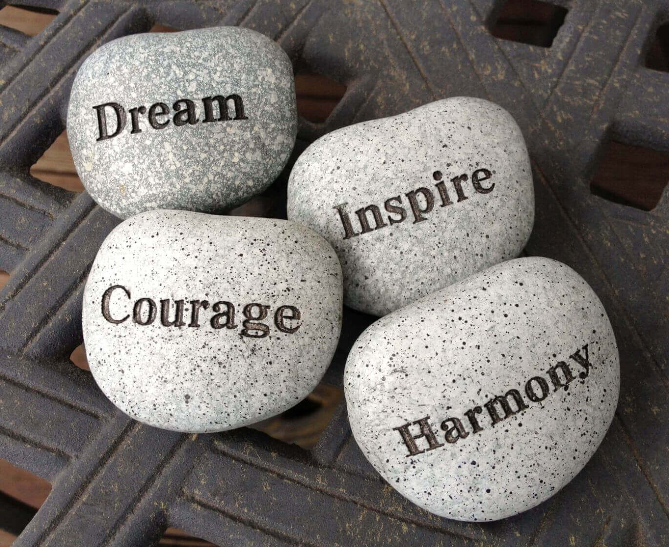Four stones with motivational words