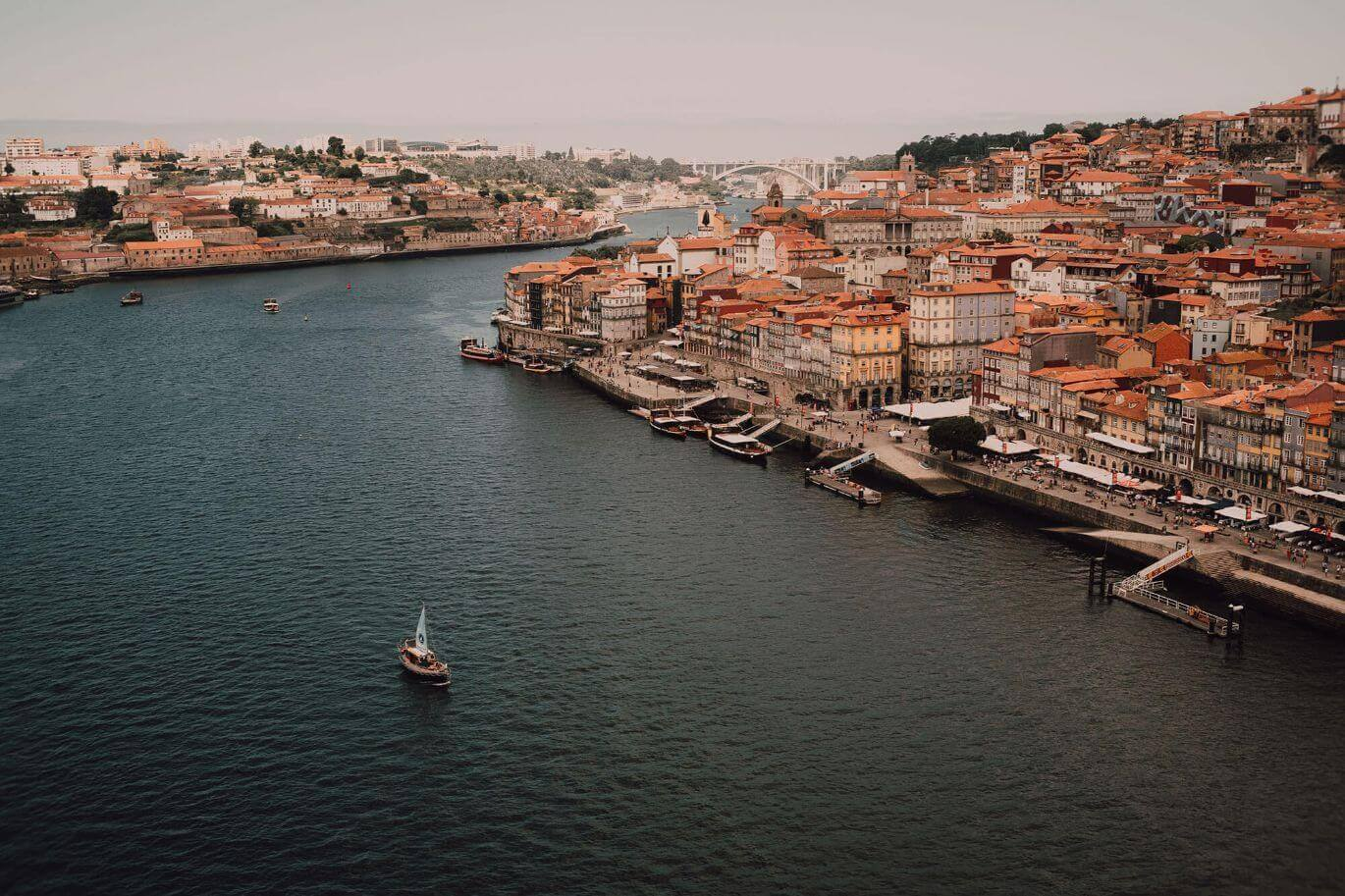 Douro river in Porto with buildings and bridge at the back