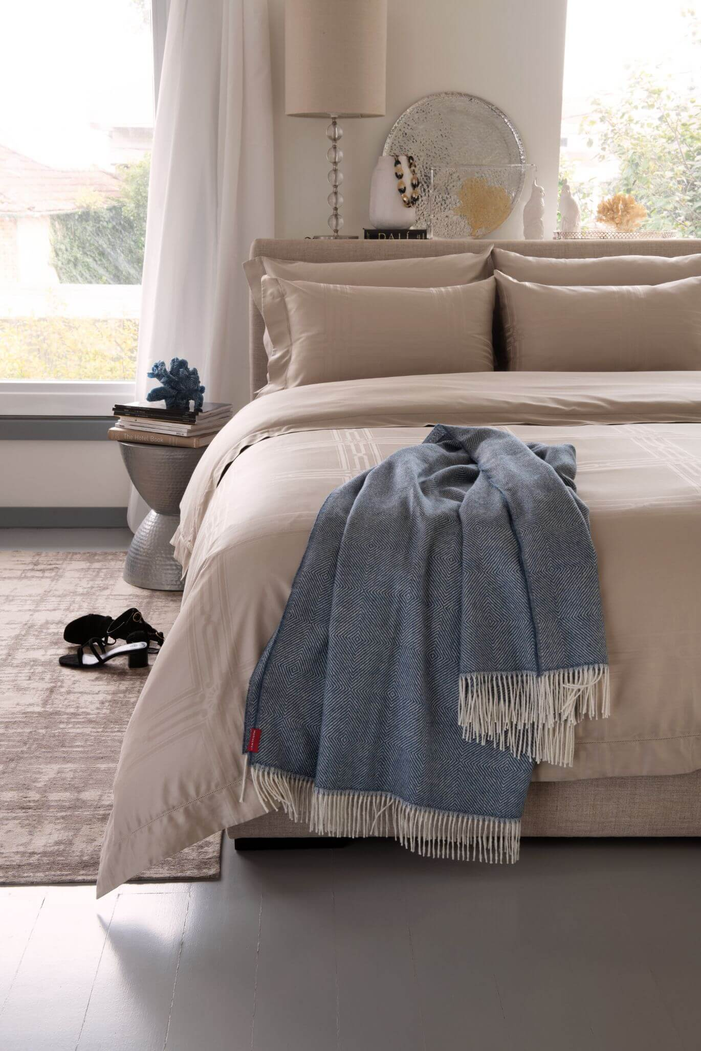 Marialma's Classic Blue Alpaca Throw in bedroom with Marialma's Light Taupe Sheets