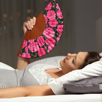 woman with night sweats and fan